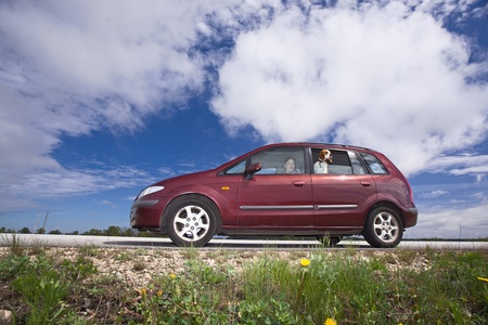 minivan on a background of cloudy sky. Stock Photo