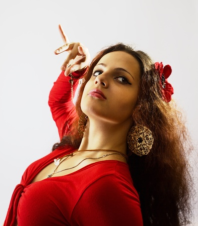 young woman in red costume dancing flamenco. photo