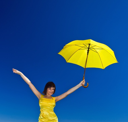 yellow dress: Young  girl with umbrella . The polarising filter is used.
