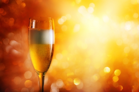 champagne in wineglass on a bright background. photo