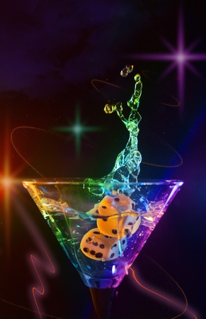 dice fall in a glass with martini. Stock Photo - 11865600