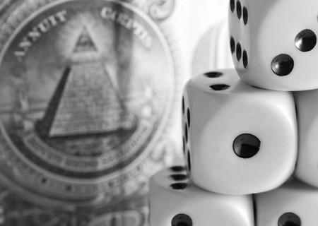 risking: Pyramid from cubes for dicing against a banknote Stock Photo