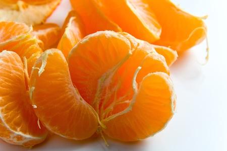 sours: ripe tangerine on reflective white background. Stock Photo