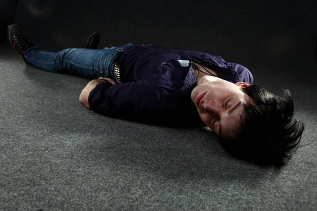The young man on a floor. photo