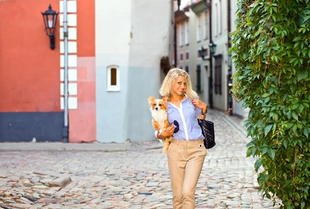 young woman with chihuahua in deserted old city. photo