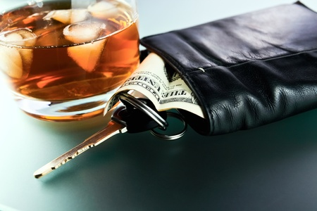 Whisky,money and key from car. Stock Photo - 12542945
