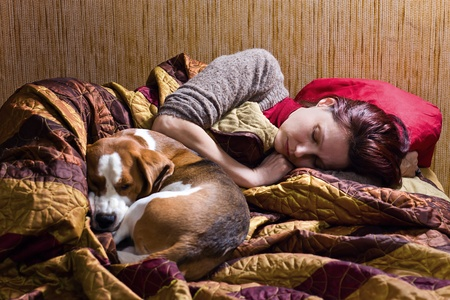 The sleeping woman and its dog . photo
