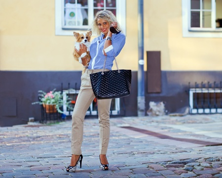 young woman with chihuahua in old city. Stock Photo - 13048487