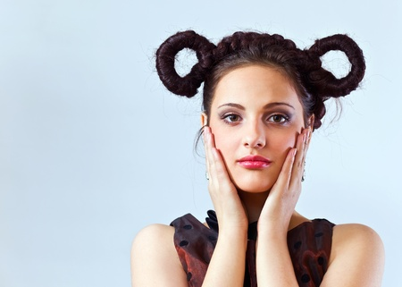 Portrait of the young beautiful girl with a professional make-up and hairdo. Stock Photo