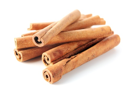 cinnamon sticks on a white background. Stock Photo - 13378346
