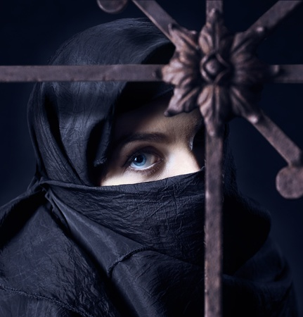 rust covered: The arabic woman in a black coverlet