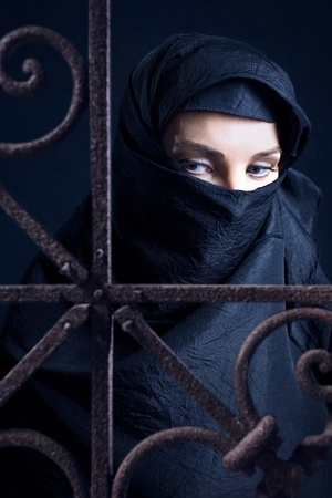 coverlet: The arabic woman in a black coverlet. Stock Photo