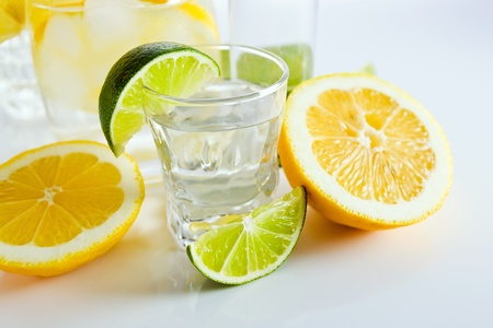 drinks with lemon and lime, shot on reflective white background. Stock Photo - 13742185