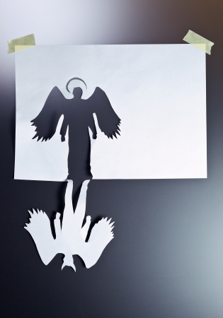 heaven and hell: angel and devil , place your text on a white paper.  Stock Photo