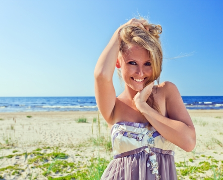 happy woman in  sundress on a beach. photo