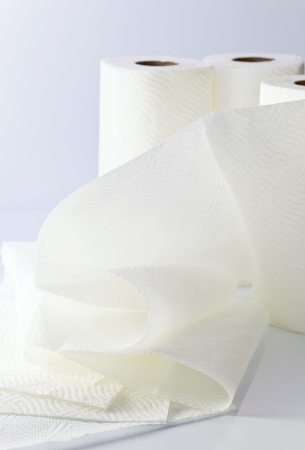 White paper towel on a white reflective background. Stock Photo