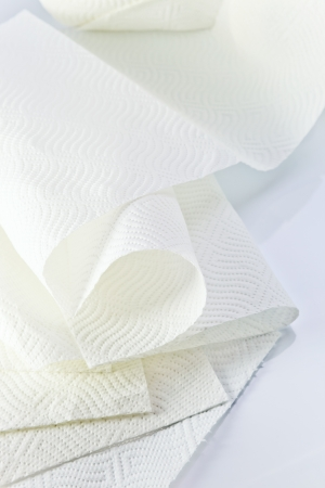 White paper towel on a white reflective background. photo