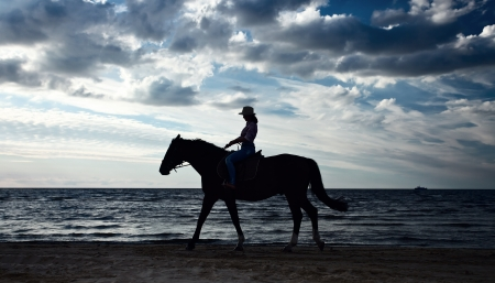 sea horse: young  beautiful girl with horse on seacoast Stock Photo