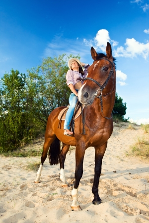 young beautiful girl with horse in forest  photo
