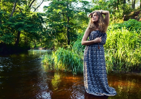 beautiful girl with long hair in river photo
