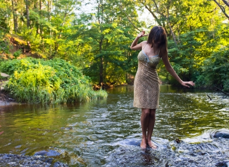 beautiful girl with long hair in river