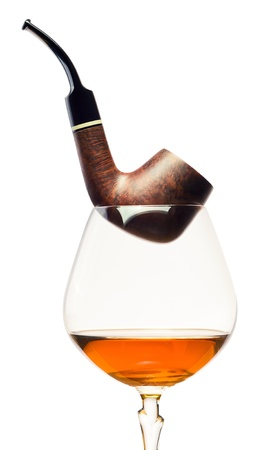 cognac and pipe isolated on a white background  photo