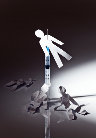 artistic addiction: The conceptual image on a theme of narcotic dependence, a white reflective background. Stock Photo