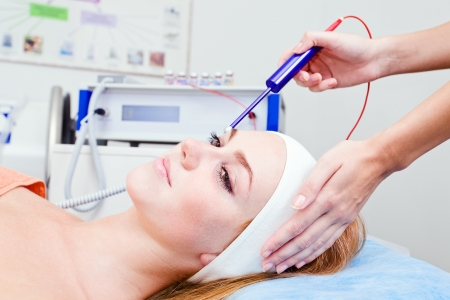 The girl doing cosmetic procedures in spa clinic Stock Photo