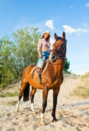 recreational: young beautiful girl with horse in forest Stock Photo