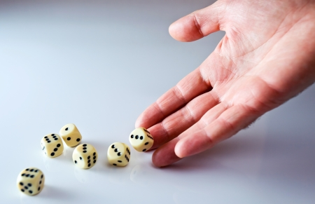 The hand of the person throwing cubes for dicing. Stock Photo