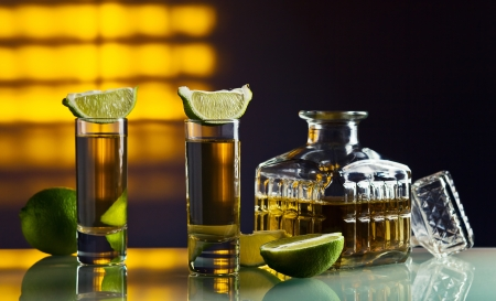 gold tequila and lime on a glass table. Stock Photo - 15872392