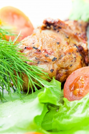 Fried chicken with fresh fennel and salad. photo