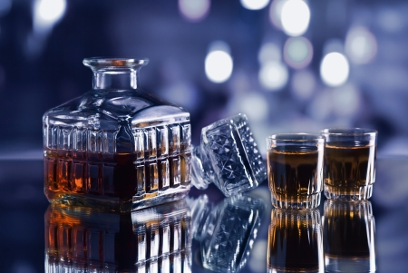 Crystal Whiskey Decanter On A Glass Table In Bar Photo