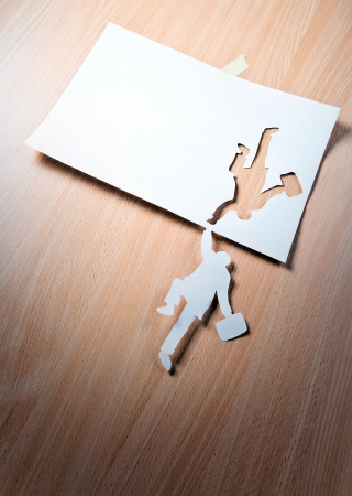 stockholder: The concept image, the paper person tries will be kept. Stock Photo