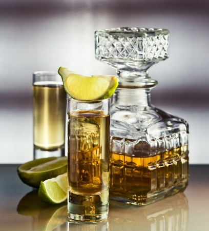 gold tequila and lime on a glass table. Stock Photo - 16000705