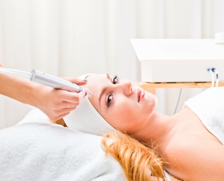 cosmetologist: The girl doing cosmetic procedures in spa clinic
