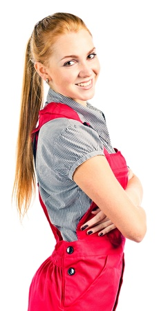 Young happy woman in red overalls , isolated on white photo