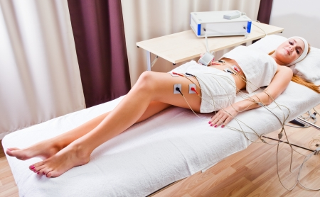 The girl doing  procedures in spa clinic