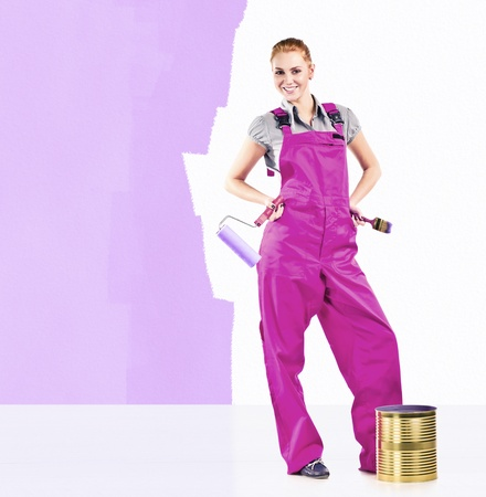 Young woman in purple overalls with painting tools  photo