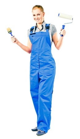 Young woman in blue overalls with painting tools , isolated on white photo