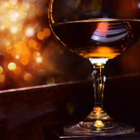 piano closeup: brandy for the maestro, snifter with brandy on a piano.