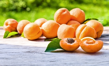ripe apricots on a old wooden table photo