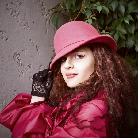 The young beautiful woman  in red  hat. photo