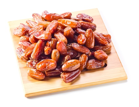 macr: Dried dates isolated on a white background