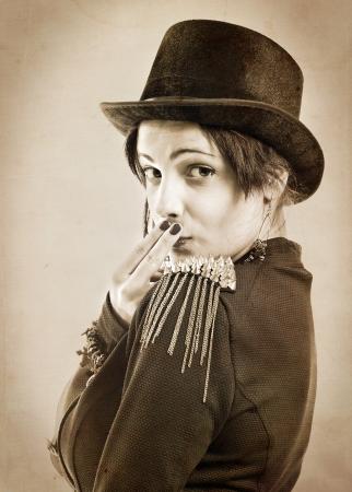 The actress of a cabaret imitates Charlie Chaplin,sepia