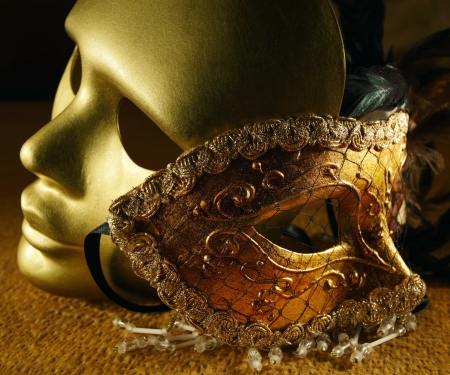 theatre costumes: Old golden Venetian masks , focus on a center