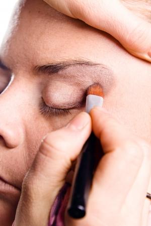 make up artist: make up artist applying make up on actress
