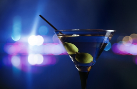 martini: green olives in wineglass,focus on a olives Stock Photo