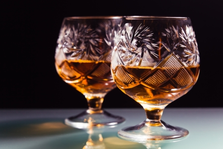 shot of a cut crystal glass containing brandy.  Stock Photo