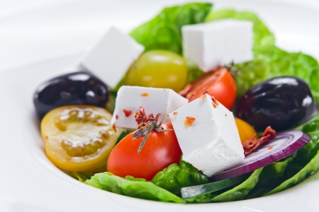 Greek salad with tomatoes cherry, close up photo
